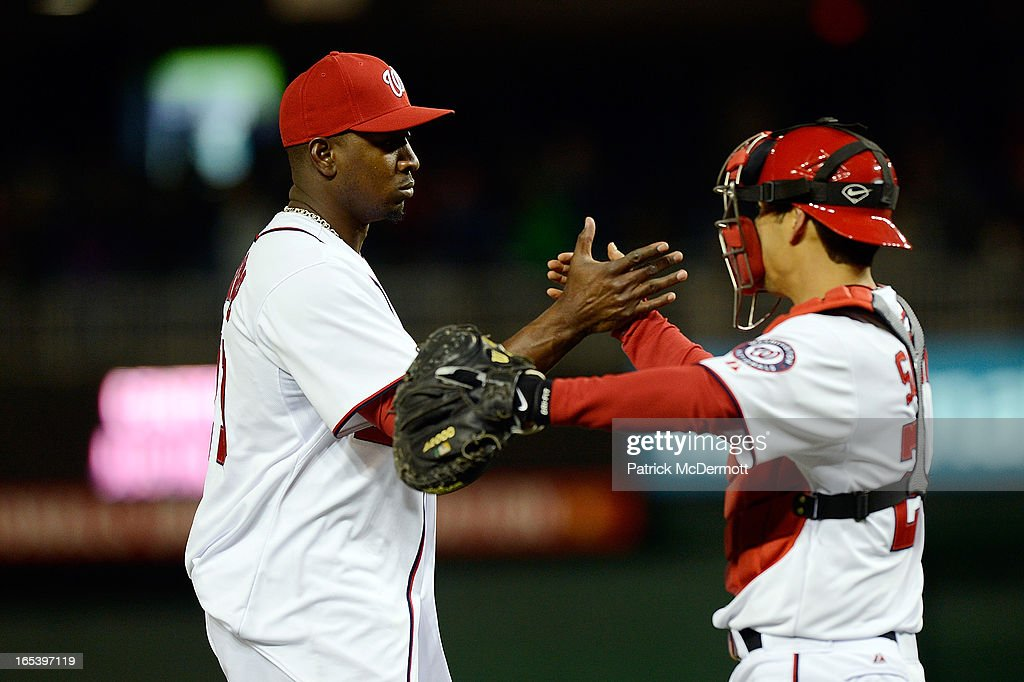 <a gi-track='captionPersonalityLinkClicked' href=/galleries/search?phrase=Rafael+Soriano&family=editorial&specificpeople=587892 ng-click='$event.stopPropagation()'>Rafael Soriano</a> #29 celebrates with <a gi-track='captionPersonalityLinkClicked' href=/galleries/search?phrase=Kurt+Suzuki&family=editorial&specificpeople=682702 ng-click='$event.stopPropagation()'>Kurt Suzuki</a> #24 of the Washington Nationals after defeating the Miami Marlins 3-0 at Nationals Park on April 3, 2013 in Washington, DC.