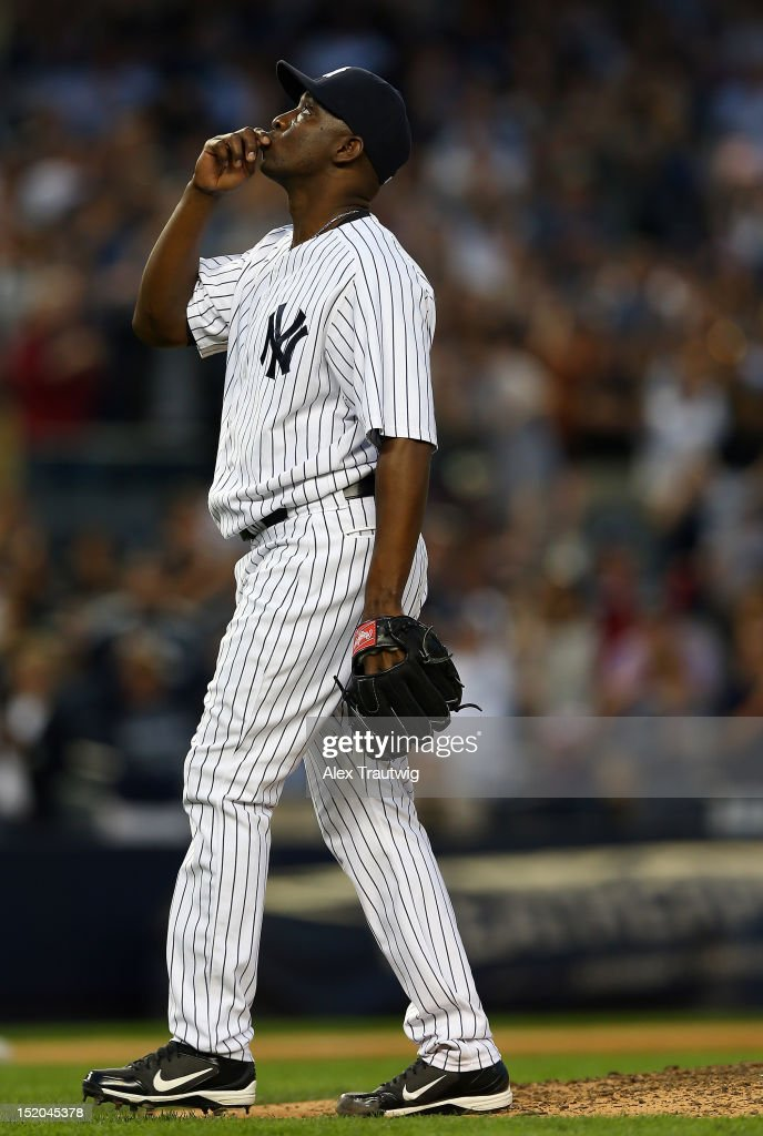 <a gi-track='captionPersonalityLinkClicked' href=/galleries/search?phrase=Rafael+Soriano&family=editorial&specificpeople=587892 ng-click='$event.stopPropagation()'>Rafael Soriano</a> #29 of the New York Yankees celebrates the win over the Tampa Bay Rays on September 15, 2012 at Yankee Stadium in the Bronx borough of New York City. The New York Yankees defeated the Tampa Bay Rays 5-3.