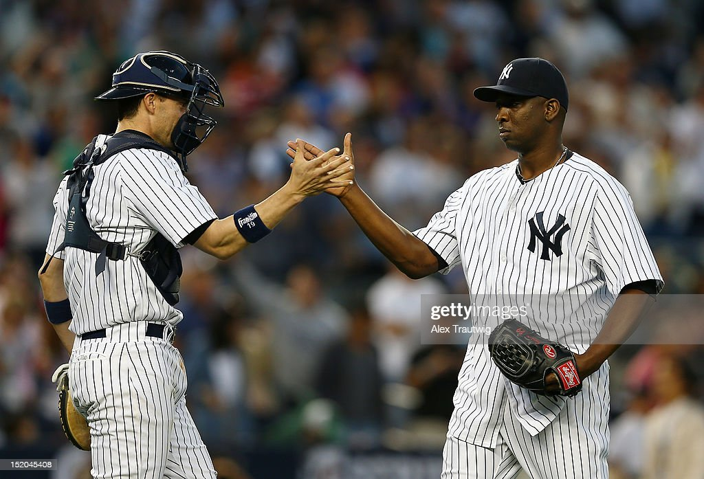 <a gi-track='captionPersonalityLinkClicked' href=/galleries/search?phrase=Rafael+Soriano&family=editorial&specificpeople=587892 ng-click='$event.stopPropagation()'>Rafael Soriano</a> #29 of the New York Yankees celebrates with teammate Chris Stewart #10 after the win over the Tampa Bay Rays on September 15, 2012 at Yankee Stadium in the Bronx borough of New York City. The New York Yankees defeated the Tampa Bay Rays 5-3.