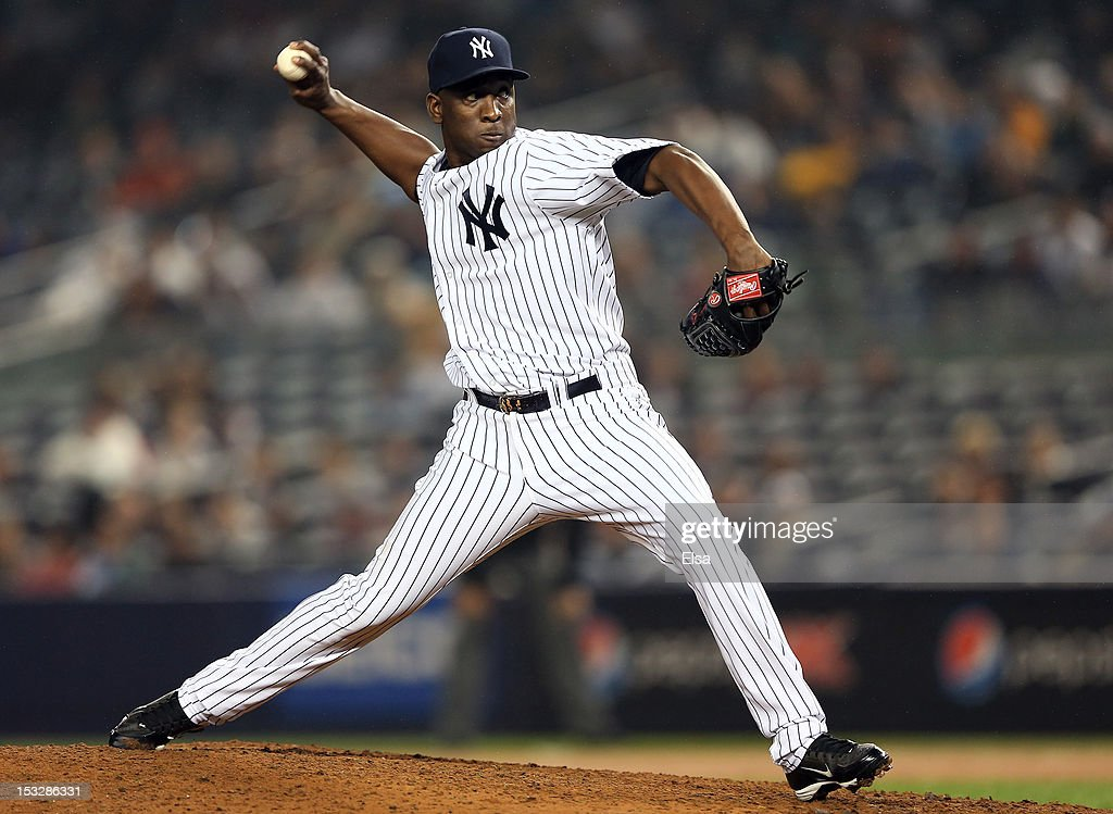 <a gi-track='captionPersonalityLinkClicked' href=/galleries/search?phrase=Rafael+Soriano&family=editorial&specificpeople=587892 ng-click='$event.stopPropagation()'>Rafael Soriano</a> #29 of the New York Yankees delivers a pitch against the Boston Red Sox on October 2, 2012 at Yankee Stadium in the Bronx borough of New York City.