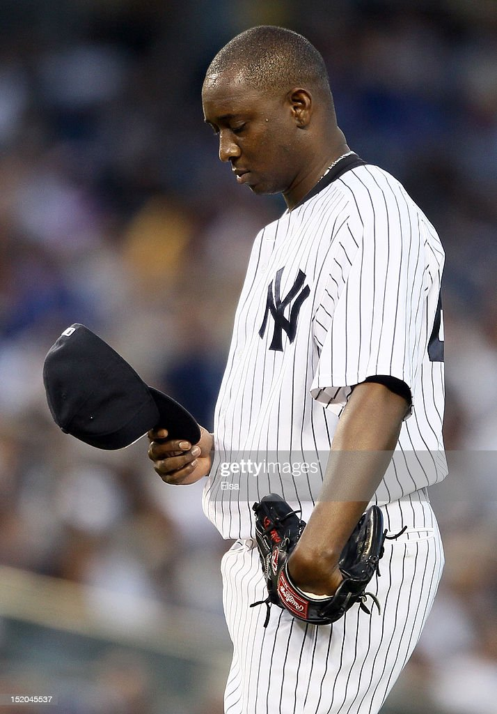 <a gi-track='captionPersonalityLinkClicked' href=/galleries/search?phrase=Rafael+Soriano&family=editorial&specificpeople=587892 ng-click='$event.stopPropagation()'>Rafael Soriano</a> #29 of the New York Yankees pauses before the next the Tampa Bay Rays batter on September 15, 2012 at Yankee Stadium in the Bronx borough of New York City. The New York Yankees defeated the Tampa Bay Rays 5-3.