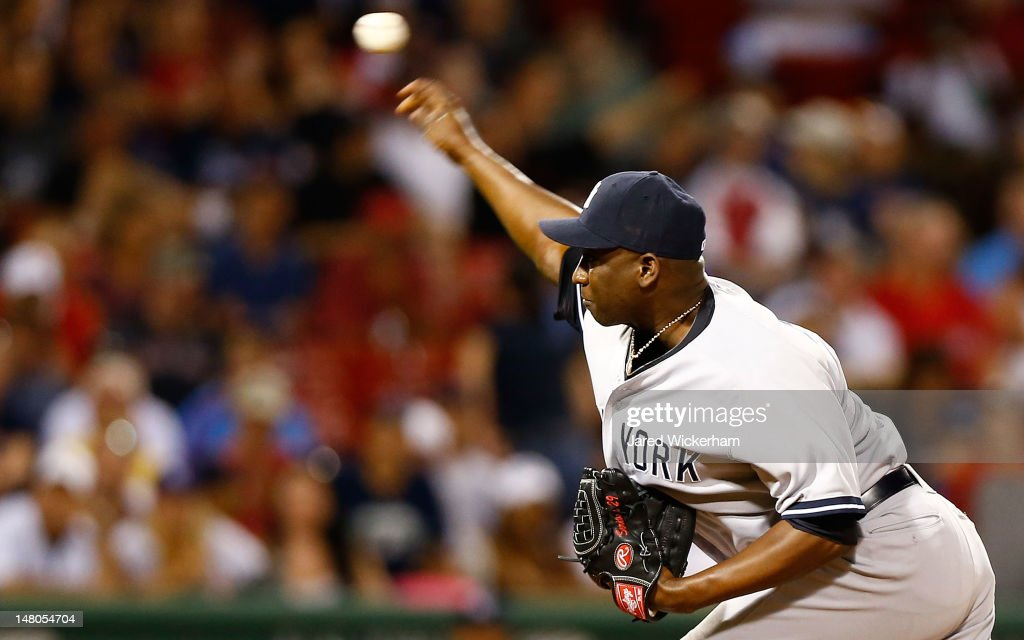 <a gi-track='captionPersonalityLinkClicked' href=/galleries/search?phrase=Rafael+Soriano&family=editorial&specificpeople=587892 ng-click='$event.stopPropagation()'>Rafael Soriano</a> #29 of the New York Yankees pitches against the Boston Red Sox during the game on July 8, 2012 at Fenway Park in Boston, Massachusetts.