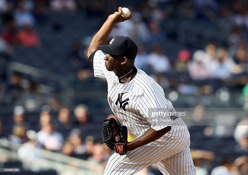 <a gi-track='captionPersonalityLinkClicked' href=/galleries/search?phrase=Rafael+Soriano&family=editorial&specificpeople=587892 ng-click='$event.stopPropagation()'>Rafael Soriano</a> #29 of the New York Yankees pitches against the Tampa Bay Rays at Yankee Stadium on September 16, 2012 in the Bronx borough of New York City.