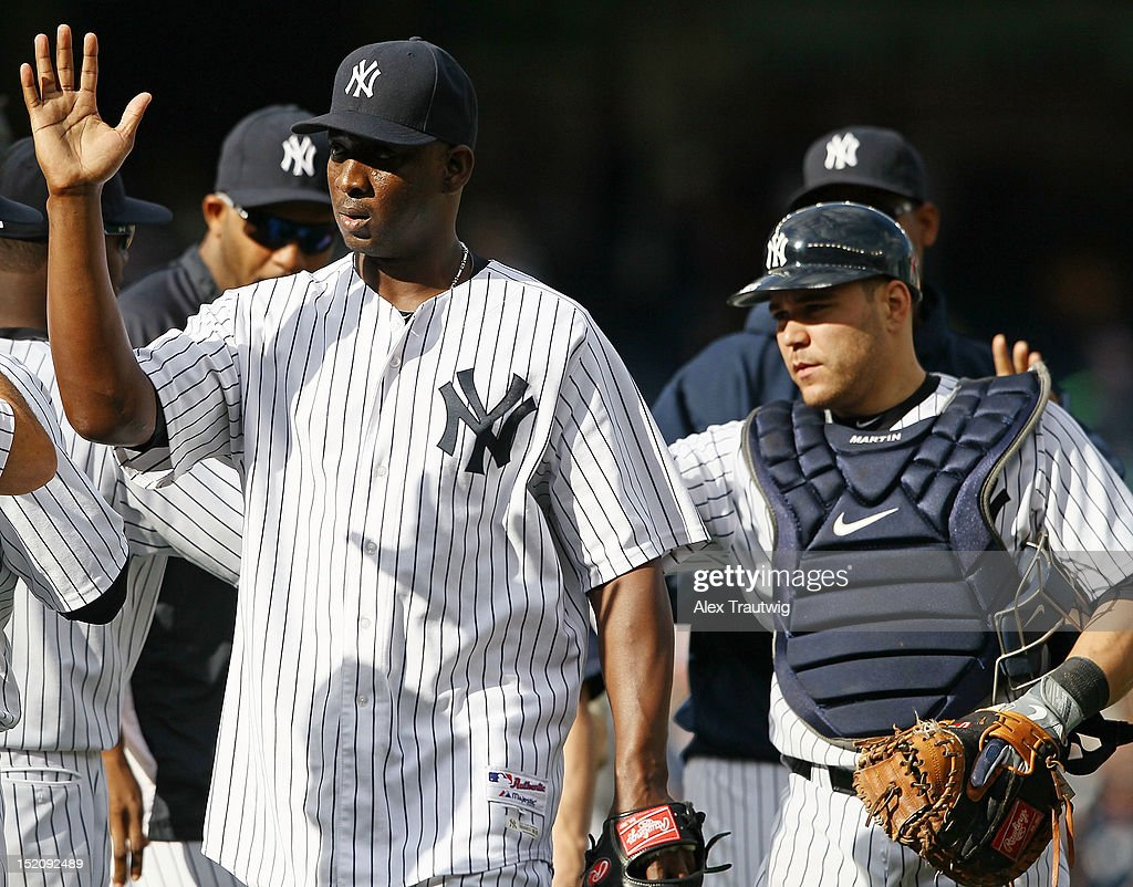 <a gi-track='captionPersonalityLinkClicked' href=/galleries/search?phrase=Rafael+Soriano&family=editorial&specificpeople=587892 ng-click='$event.stopPropagation()'>Rafael Soriano</a> #29 of the New York Yankees shakes hands with teammates after defeating the Tampa Bay Rays at Yankee Stadium on September 16, 2012 in the Bronx borough of New York City.