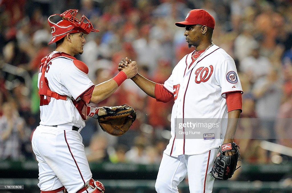 <a gi-track='captionPersonalityLinkClicked' href=/galleries/search?phrase=Rafael+Soriano&family=editorial&specificpeople=587892 ng-click='$event.stopPropagation()'>Rafael Soriano</a> #29 of the Washington Nationals celebrates with <a gi-track='captionPersonalityLinkClicked' href=/galleries/search?phrase=Wilson+Ramos&family=editorial&specificpeople=4866956 ng-click='$event.stopPropagation()'>Wilson Ramos</a> #40 after a 2-1 victory against the Miami Marlins at Nationals Park on August 27, 2013 in Washington, DC.