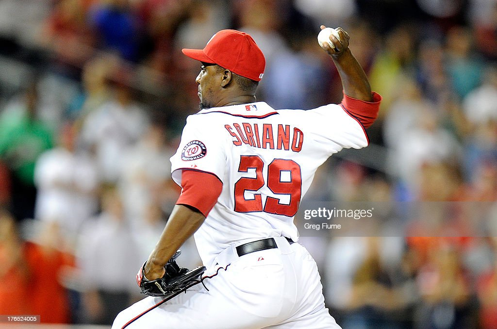 <a gi-track='captionPersonalityLinkClicked' href=/galleries/search?phrase=Rafael+Soriano&family=editorial&specificpeople=587892 ng-click='$event.stopPropagation()'>Rafael Soriano</a> #29 of the Washington Nationals pitches in the ninth inning against the San Francisco Giants at Nationals Park on August 14, 2013 in Washington, DC. Washington won the game 6-5.
