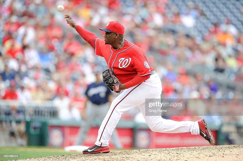<a gi-track='captionPersonalityLinkClicked' href=/galleries/search?phrase=Rafael+Soriano&family=editorial&specificpeople=587892 ng-click='$event.stopPropagation()'>Rafael Soriano</a> #29 of the Washington Nationals pitches in the ninth inning against the Milwaukee Brewers at Nationals Park on July 20, 2014 in Washington, DC.