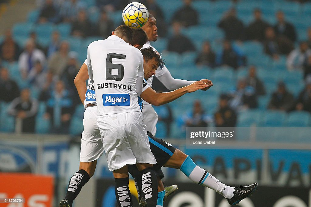 Rafael Thyere of Gremio battles for the ball against Gustavo Henrique of Santos during the match Gremio v Santos as part of Brasileirao Series A 2016, at Arena do Gremio on June 03, 2015 in Porto Alegre, Brazil.