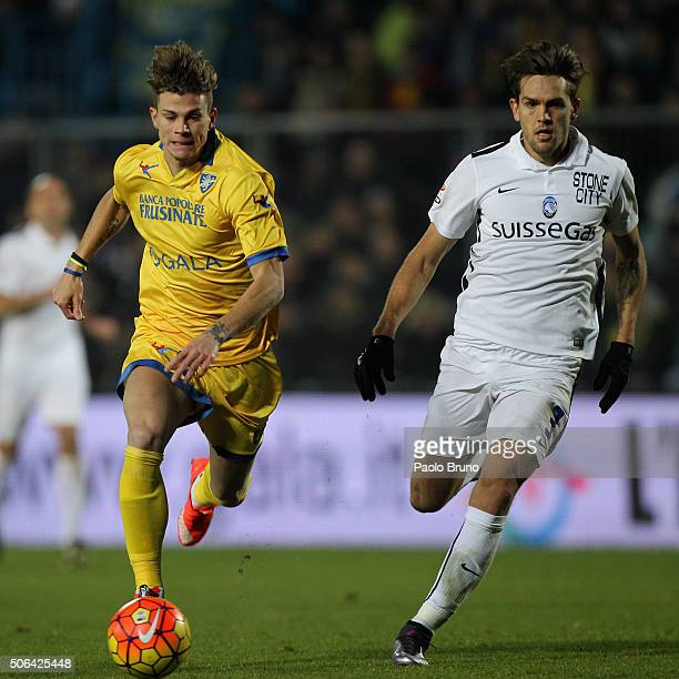 Rafael Toloi of Atalanta BC competes for the ball with Samuele Longo of Frosinone Calcio during the Serie A match between Frosinone Calcio and...