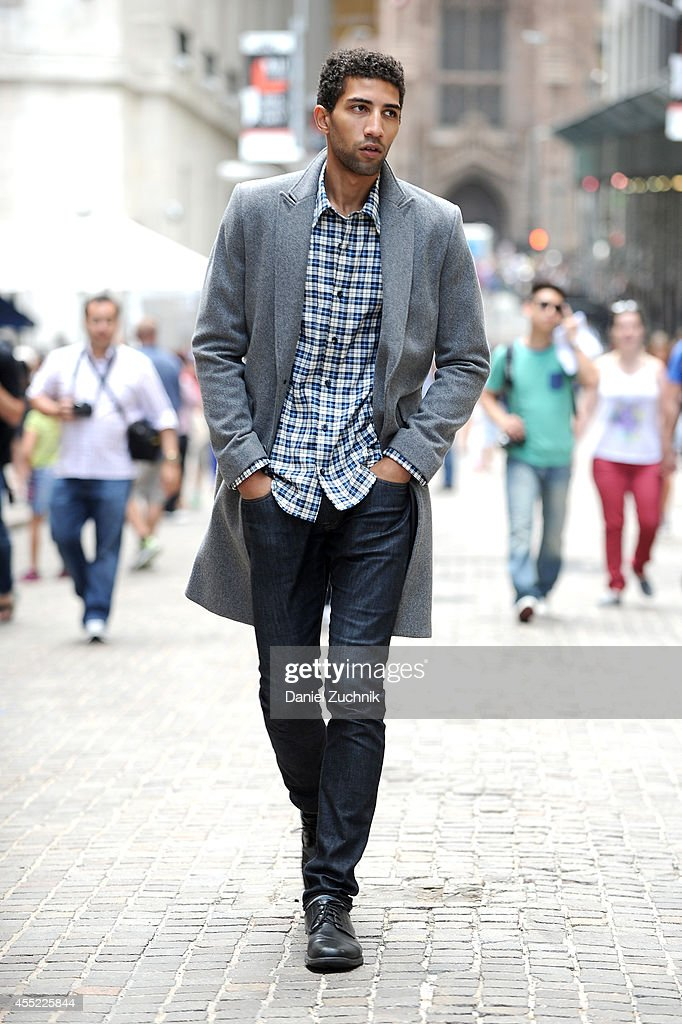 Rafael Valentino, actor and chess player, is seen wearing a Grungy Gentleman gray wool peacoat and plaid flannel shirt with suede elbow patches along with his own Armani Exchange jeans and Bostonian shoes on Wall Street on September 10, 2014 in New York City during Mercedes-Benz Fashion Week Spring 2015.