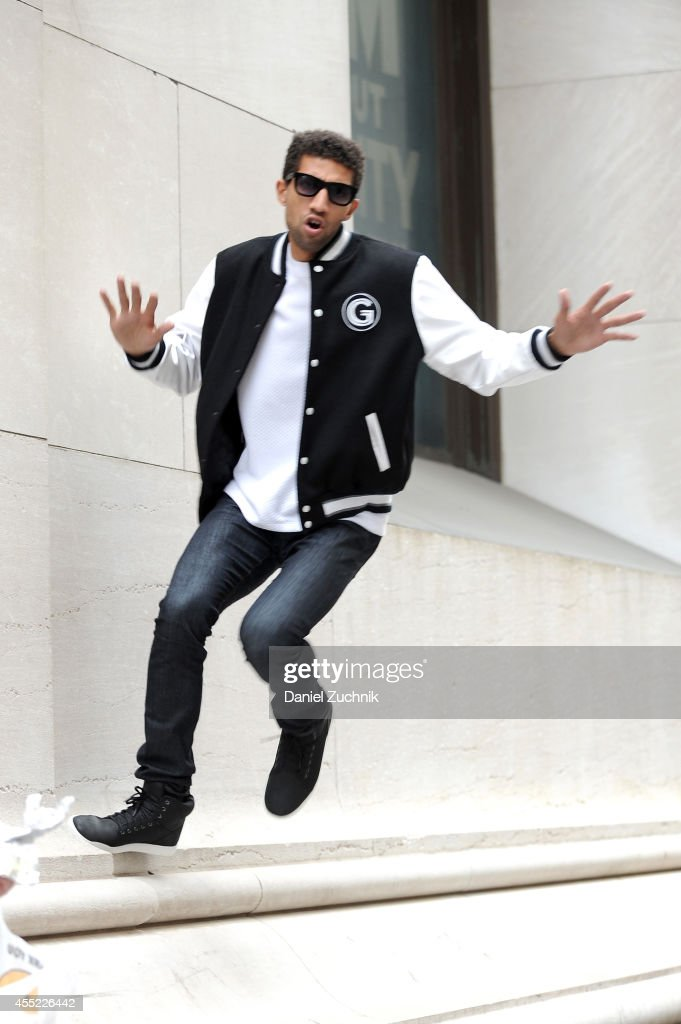 Rafael Valentino, actor and chess player, is seen wearing a Grungy Gentleman x Mitchell & Ness varsity jacket over a Grungy Gentleman Elevated Basics quilted t-shirt along with his own Armani Exchange jeans, Italia Independent sunglasses and Timberland shoes on Wall Street on September 10, 2014 in New York City during Mercedes-Benz Fashion Week Spring 2015.