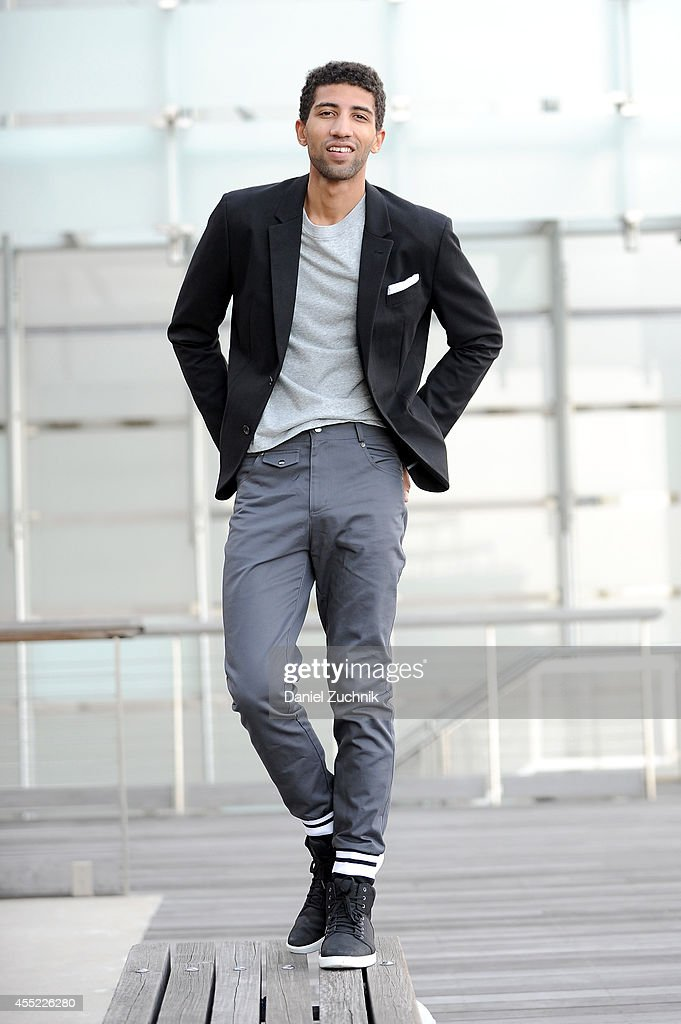 Rafael Valentino, actor and chess player, is seen wearing Grungy Gentleman pants with cuffed hems and a gray long-sleeve t-shirt with his own Armani Exchange blazer, RETROSUPERFUTURE sunglasses and Timberland shoes in lower Manhattan on September 10, 2014 in New York City during Mercedes-Benz Fashion Week Spring 2015.