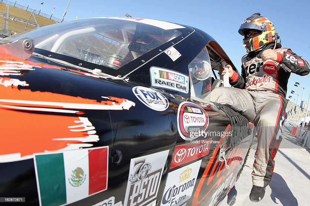 Rafael Vallina, driver of the #77 Coca-Cola/Bokados/Mobil1 Chevrolet, climbs into his car during NASCAR Mexico Toyota Series practice practice for the NASCAR Mexico Toyota Series 75 at Phoenix International Raceway on February 28, 2013 in Avondale, Arizona.