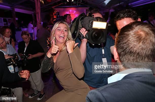 Rafael van der Vaart and his girlfriend Estavana Polman jokes during the Raffaello Summer Day 2016 to celebrate the 26th anniversary of Raffaello on...