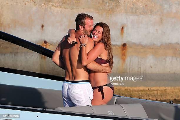 Rafael Van Der Vaart and his girlfriend Sabia Boulahrouz enjoy a boat ride on July 15 2014 in SaintTropez France