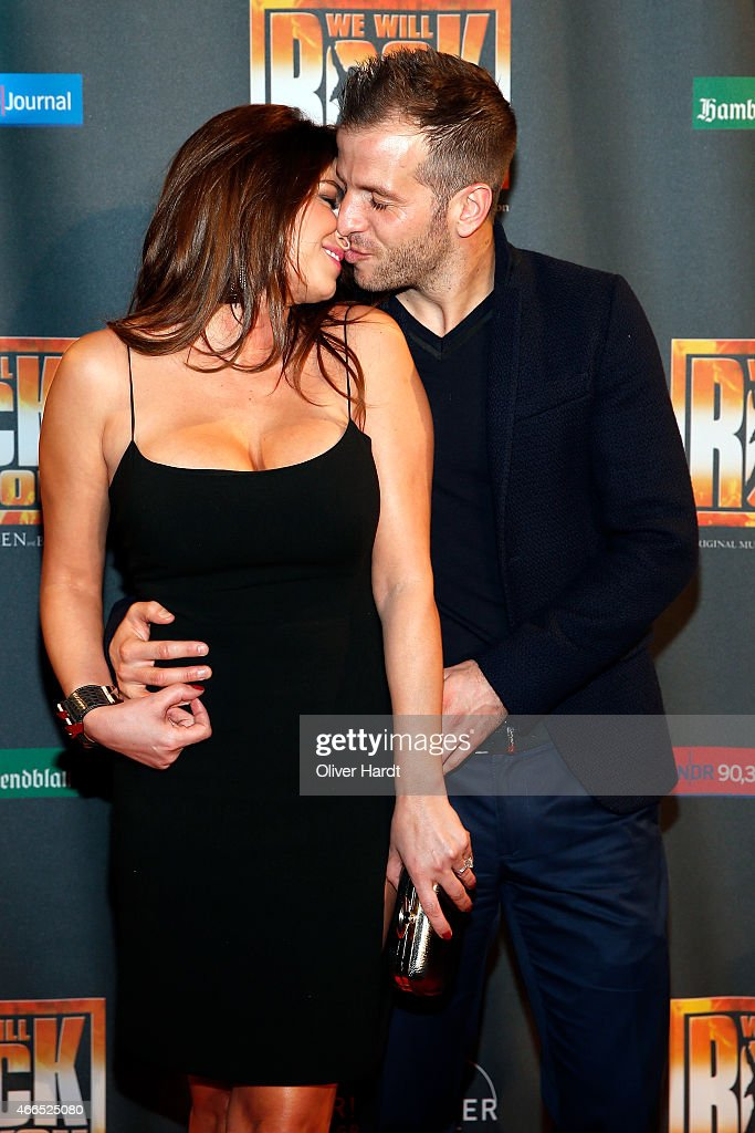 <a gi-track='captionPersonalityLinkClicked' href=/galleries/search?phrase=Rafael+van+der+Vaart&family=editorial&specificpeople=210815 ng-click='$event.stopPropagation()'>Rafael van der Vaart</a> and his girlfriend <a gi-track='captionPersonalityLinkClicked' href=/galleries/search?phrase=Sabia+Boulahrouz&family=editorial&specificpeople=4052776 ng-click='$event.stopPropagation()'>Sabia Boulahrouz</a> kiss during the premiere of the musical 'We Will Rock You' on March 16, 2015 in Hamburg, Germany.