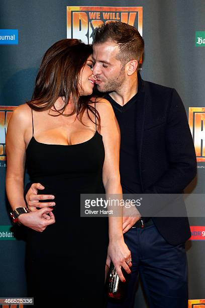 Rafael van der Vaart and his girlfriend Sabia Boulahrouz kiss during the premiere of the musical 'We Will Rock You' on March 16 2015 in Hamburg...