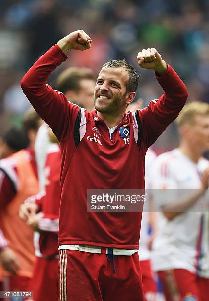 Rafael van der Vaart capatain of Hamburg celebrates at the end of the Bundeslga match between Hamburger SV and FC Augsburg at Imtech Arena on April...