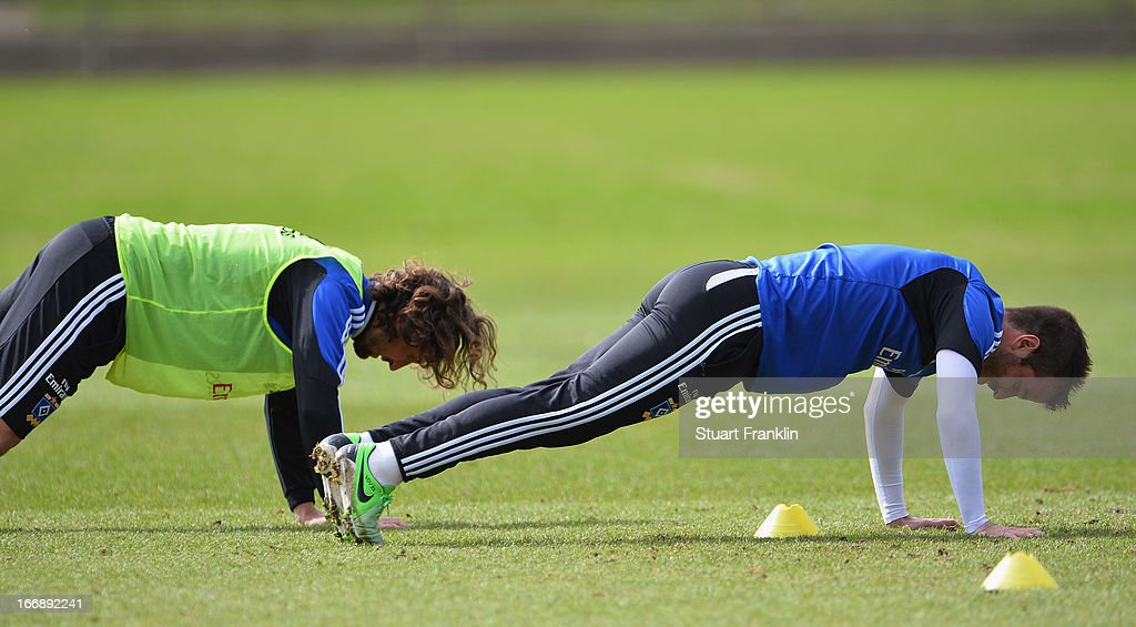 Rafael van der Vaart, captain of Hamburg does press ups with Petr Jiracek during a training session of Hamburger SV on April 18, 2013 in Hamburg, Germany.