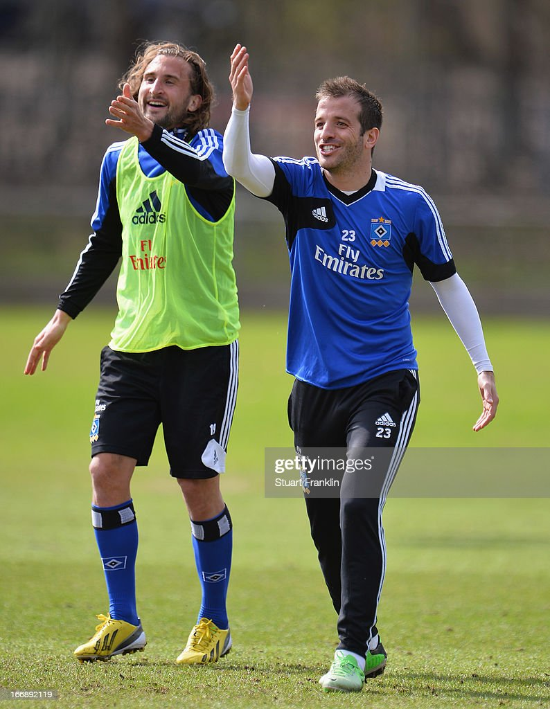 Rafael van der Vaart, captain of Hamburg gestures with Petr Jiracek during a training session of Hamburger SV on April 18, 2013 in Hamburg, Germany.