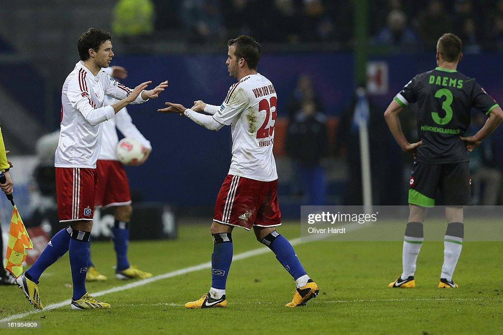 Rafael van der Vaart (R) his substitution with Marcus Berg (L) of Hamburg during the Bundesliga match between Hamburger SV and Borussia Moenchengladbach at Imtech Arena on February 16, 2013 in Hamburg, Germany.