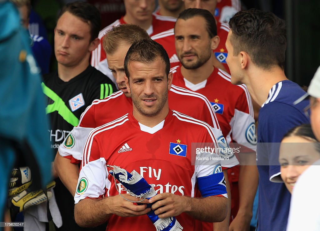 Rafael van der Vaart, Maximilian Beister and Petr Jiracek of Hamburg before match during the DFB Cup between SV Schott Jena and Hamburger SV at Ernst-Abbe-Sportfeld on August 04, 2013 in Jena,Germany.