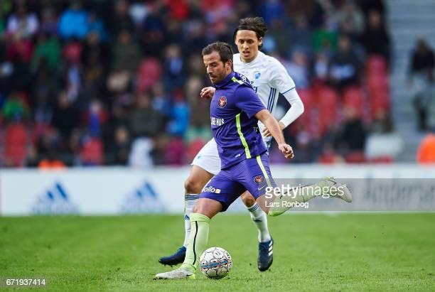 Rafael van der Vaart of FC Midtjylland and Uros Matic of FC Copenhagen compete for the ball during the Danish Alka Superliga match between FC...