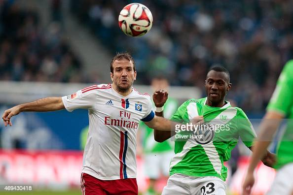 Rafael van der Vaart of Hamburg and Josuha Guilavogui of Wolfsburg compete for the ball during the First Bundesliga match between Hamburger SV and...