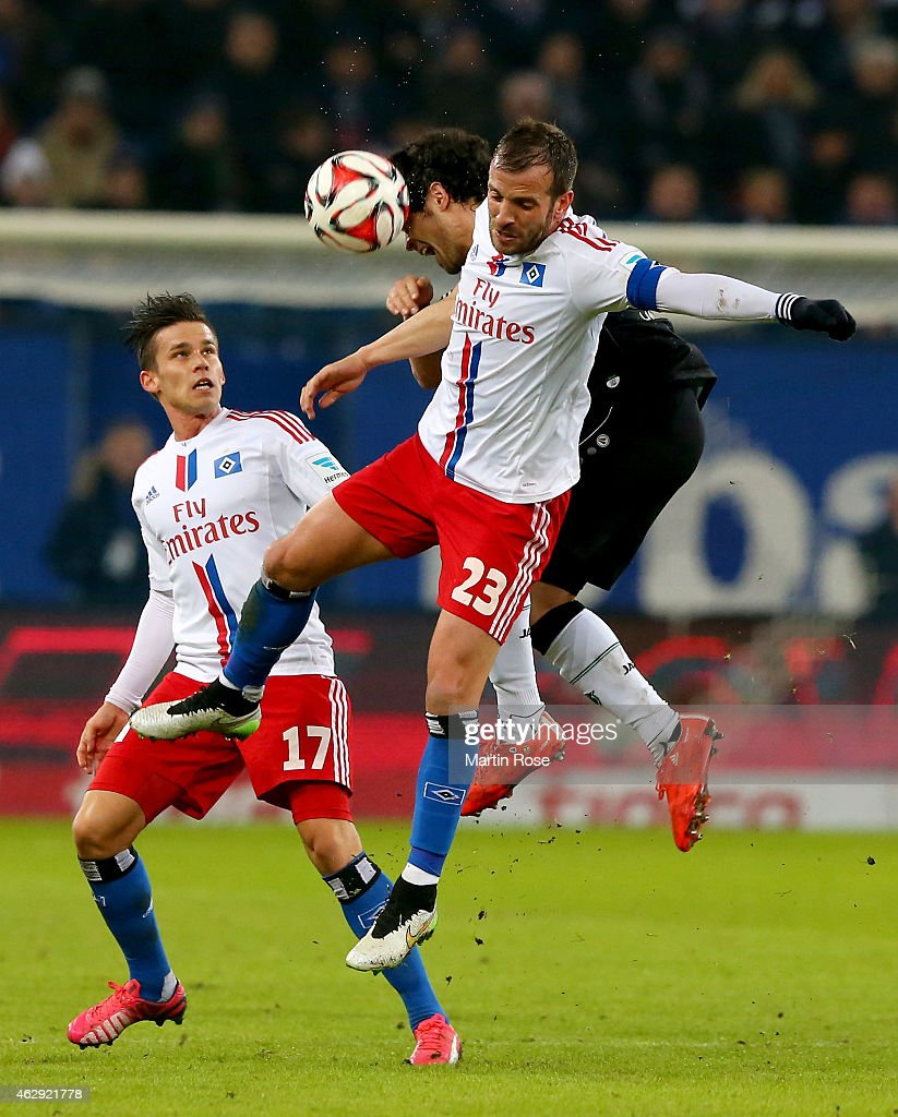 Rafael van der Vaart (L) of Hamburg and Manuel Schmiedebach of Hannover battle for the ball during the Bundesliga match between Hamburger SV and Hannover 96 at Imtech Arena on February 7, 2015 in Hamburg, Germany.