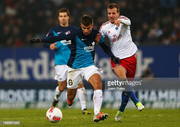 Rafael van der Vaart of Hamburg and Marco Caligiuri of Mainz compete for the ball during the Bundesliga match between Hamburger SV and 1 FSV Mainz 05...