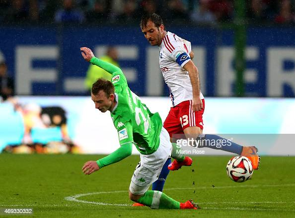 Rafael van der Vaart of Hamburg and Maxi Arnold of Wolfsburg battle for the ball during the Bundesliga match between Hamburger SV and VfL Wolfsburg...