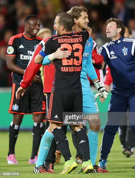 Rafael van der Vaart of Hamburg and team mate Rene Adler show their delight after winning the DFB Cup match between FC Energie Cottbus and Hamburger...
