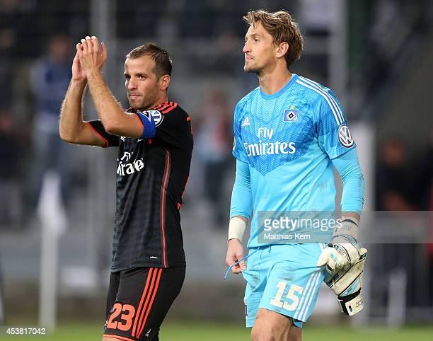 Rafael van der Vaart of Hamburg and team mate Rene Adler show their delight after winning the DFB Cup match between FC Energie Cottbus and Hamburger...