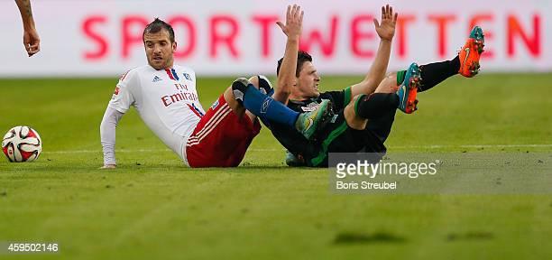 Rafael van der Vaart of Hamburg and Zlatko Junuzovic of Bremen react during the Bundesliga match between Hamburger SV and SV Werder Bremen at Imtech...
