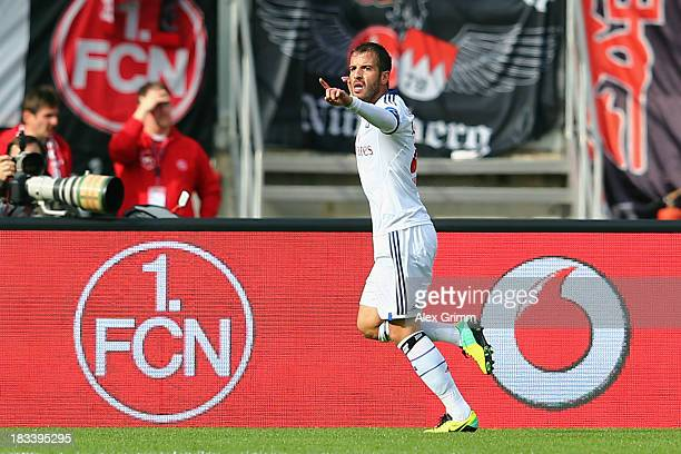 Rafael van der Vaart of Hamburg celebrates his team's first goal during the Bundesliga match between 1 FC Nuernberg and Hamburger SV at Grundig...