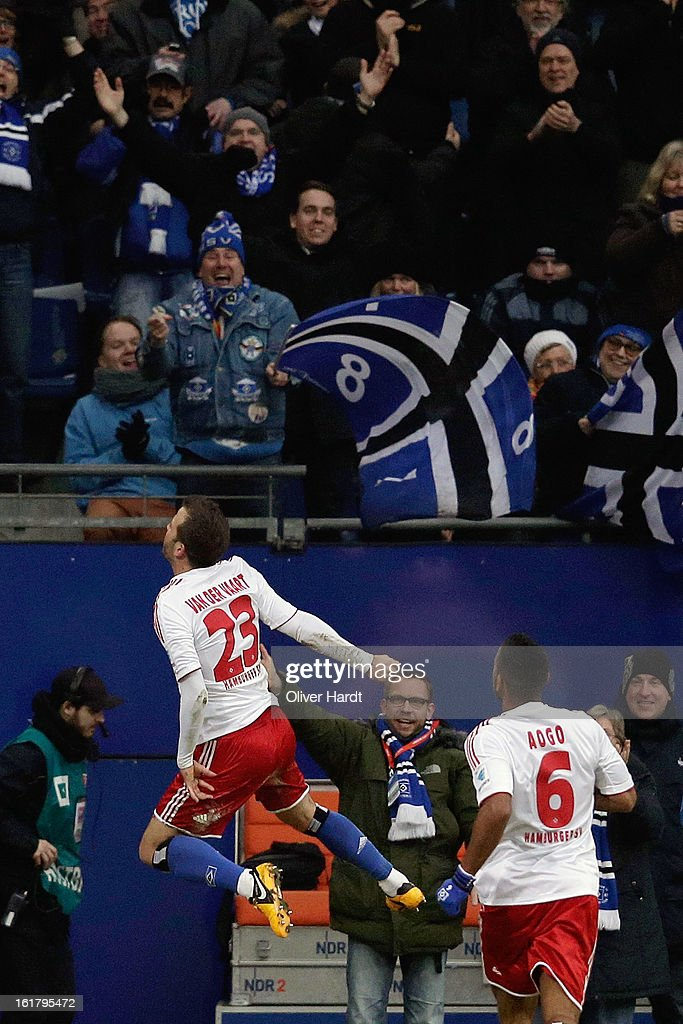 Rafael van der Vaart (L) of Hamburg celebrates in front of the fans with teammate Dennis Aogo after scoring the opening goal during the Bundesliga match between Hamburger SV and Borussia Moenchengladbach at Imtech Arena on February 16, 2013 in Hamburg, Germany.