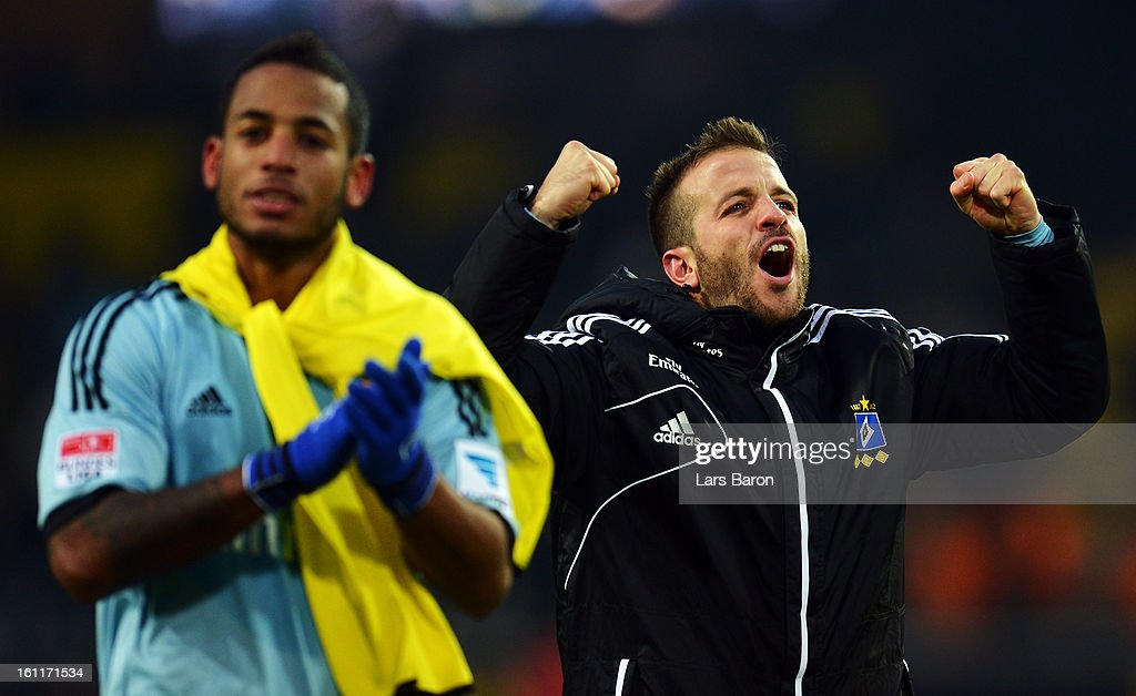 Rafael van der Vaart of Hamburg celebrates next to team mate <a gi-track='captionPersonalityLinkClicked' href=/galleries/search?phrase=Dennis+Aogo&family=editorial&specificpeople=787086 ng-click='$event.stopPropagation()'>Dennis Aogo</a> after winning the Bundesliga match between Borussia Dortmund and Hamburger SV at Signal Iduna Park on February 9, 2013 in Dortmund, Germany.