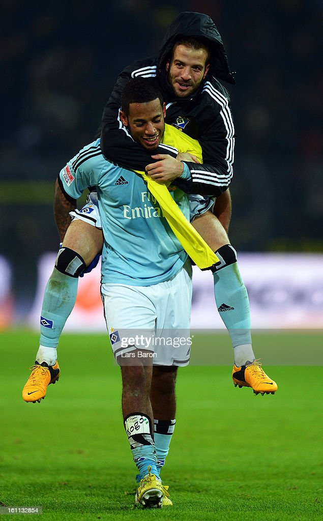 Rafael van der Vaart of Hamburg celebrates with <a gi-track='captionPersonalityLinkClicked' href=/galleries/search?phrase=Dennis+Aogo&family=editorial&specificpeople=787086 ng-click='$event.stopPropagation()'>Dennis Aogo</a> after winning the Bundesliga match between Borussia Dortmund and Hamburger SV at Signal Iduna Park on February 9, 2013 in Dortmund, Germany.