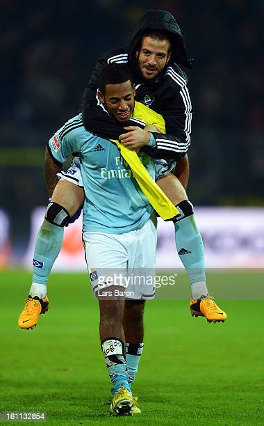 Rafael van der Vaart of Hamburg celebrates with Dennis Aogo after winning the Bundesliga match between Borussia Dortmund and Hamburger SV at Signal...
