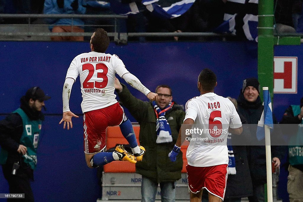 Rafael van der Vaart of Hamburg celebrates with team-mate <a gi-track='captionPersonalityLinkClicked' href=/galleries/search?phrase=Dennis+Aogo&family=editorial&specificpeople=787086 ng-click='$event.stopPropagation()'>Dennis Aogo</a> after scoring the opening goal of the Bundesliga match between Hamburger SV and Borussia Moenchengladbach at Imtech Arena on February 16, 2013 in Hamburg, Germany.
