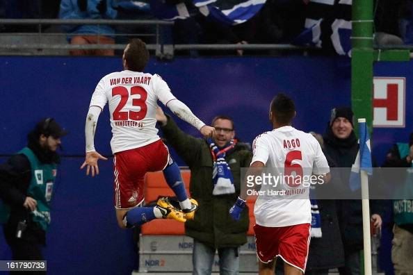 Rafael van der Vaart of Hamburg celebrates with teammate Dennis Aogo after scoring the opening goal of the Bundesliga match between Hamburger SV and...