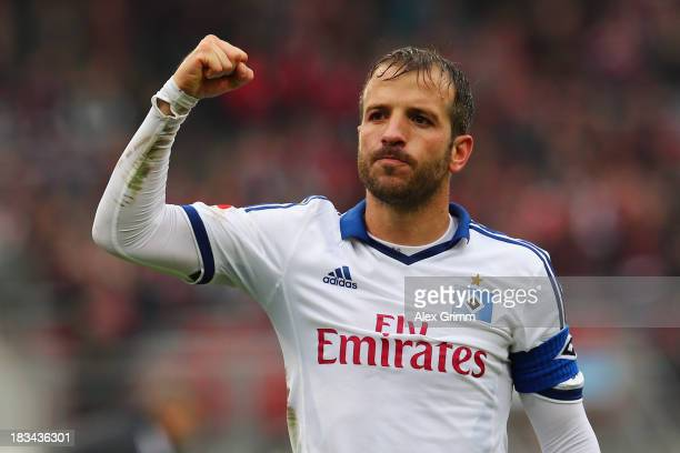 Rafael van der Vaart of Hamburg celebrates with the fans after the Bundesliga match between 1 FC Nuernberg and Hamburger SV at Grundig Stadium on...