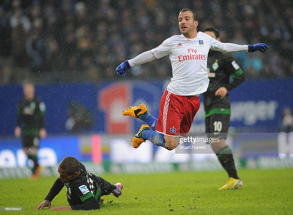 Rafael van der Vaart of Hamburg challenges for the ball with <a gi-track='captionPersonalityLinkClicked' href=/galleries/search?phrase=Theodor+Gebre+Selassie&family=editorial&specificpeople=8202004 ng-click='$event.stopPropagation()'>Theodor Gebre Selassie</a> of Bremen during the Bundesliga match between Hamburger SV and SV Werder Bremen at Imtech Arena on January 27, 2013 in Hamburg, Germany.