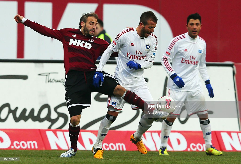 Rafael van der Vaart (R) of Hamburg is challenged by Javier Pinola of Nuernberg during the Bundesliga match between 1. FC Nuernberg and Hamburger SV at Easy Credit Stadium on January 20, 2013 in Nuremberg, Germany.