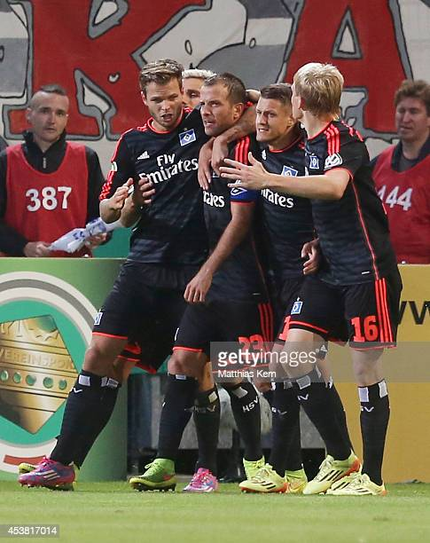Rafael van der Vaart of Hamburg jubilates with team mates after scoring the third goal during the DFB Cup match between FC Energie Cottbus and...