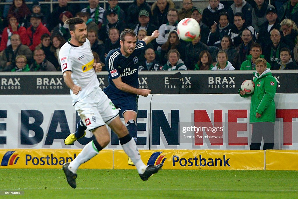 Rafael van der Vaart of Hamburg scores his team's first goal during the Bundesliga match between Borussia Moenchengladbach and Hamburger SV at...