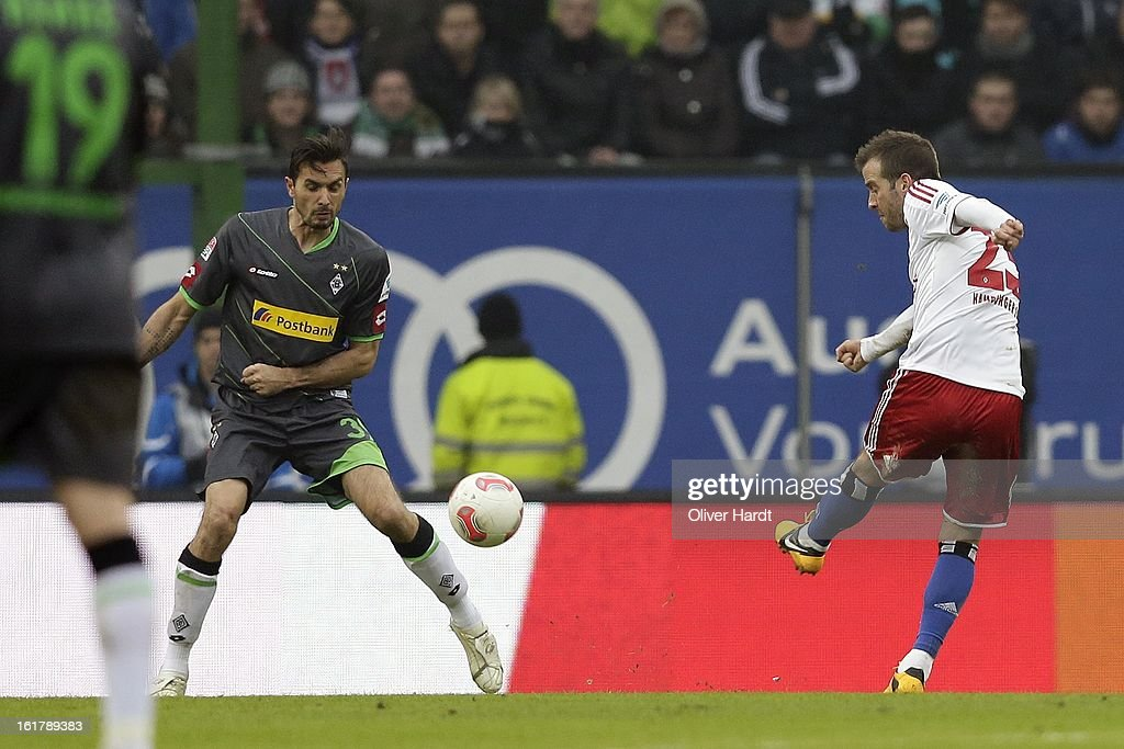 Rafael van der Vaart (R) of Hamburg shoots the deciding goal during the Bundesliga match between Hamburger SV and Borussia Moenchengladbach at Imtech Arena on February 16, 2013 in Hamburg, Germany.