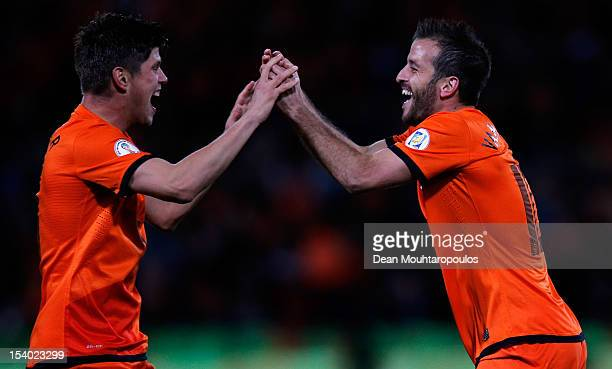 Rafael Van der Vaart of Netherlands celebrates with team mate KlaasJan Huntelaar after scoring the first goal of the game during the FIFA 2014 World...
