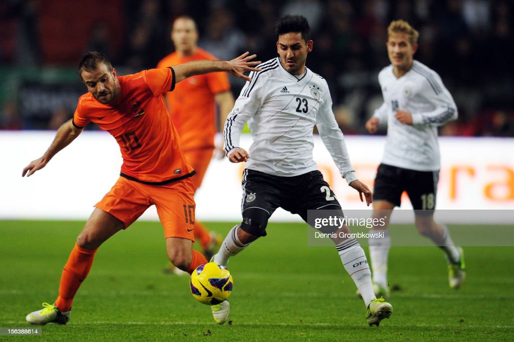 Rafael van der Vaart of Netherlands is chased by <a gi-track='captionPersonalityLinkClicked' href=/galleries/search?phrase=Ilkay+Guendogan&family=editorial&specificpeople=4956499 ng-click='$event.stopPropagation()'>Ilkay Guendogan</a> of Germany during the International Friendly match between Netherlands and Germany at Amsterdam Arena on November 14, 2012 in Amsterdam, Netherlands.