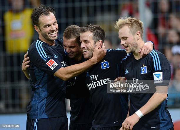 Rafael van der Vaart of of Hamburg celebrates with teammates Heiko Westermann PierreMichel Lasogga and Maximilian Beister after scoring their team's...
